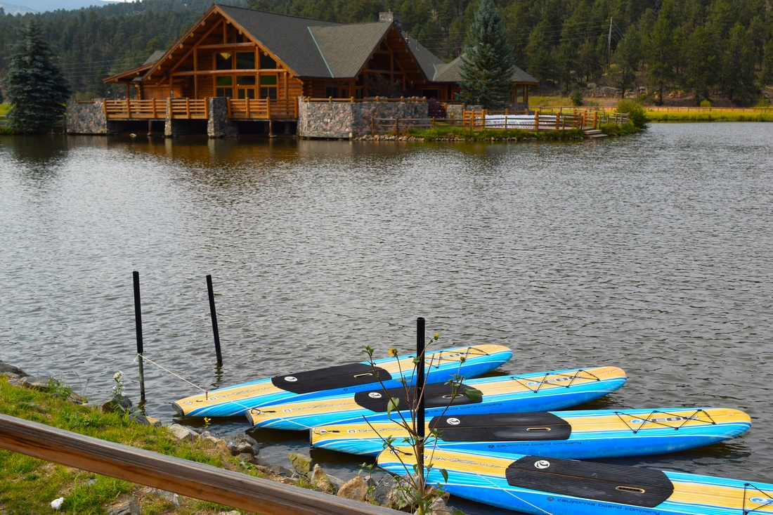 Paddle boards and Evergreen Lake House