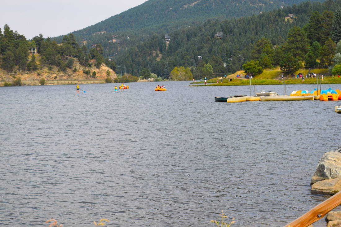 Paddling boarding on Evergreen Lake, Evergreen, Colorado